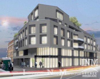 FUTUR PROJET IMMOBILIER<br>EN CONSTRUCTION<br><br>Résidence ALBERT 1 PROPERTIES (29 unités) Ecopass: BB de grand standing aux prestations haut-de-gamme avec ascenseur, située dans le quartier chic de Belair, à proximité de toutes les facilités et à quelques pas du centre ville. <br><br>Les 24 unités sont des appartements de 1 à 3 chambres à coucher dont la superficies varie de +/- 50 m2  à +/- 156 m2 et 5 unités sont des bureaux / commerces dont la superficies varie de +/- 110 m2 à 242 m2.<br><br>Rdch:<br>- Bureau / Commerce 0.1 (+/- 110 m2)<br>- Bureau / Commerce 0.2 (+/- 190 m2)<br>- Bureau / Commerce 0.3 (+/- 242 m2 et terrasse (+/- 46 m2)<br><br>1er étage:<br>- Bureau 1.3 (+/- 233 m2) et terrasse (+/- 8 m2)<br>- Bureau 1.4 (+/- 230 m2) <br>- Appartement 1.2 (+/- 64 m2) et terrasse (+/-5 m2)<br>- Appartement 1.1 (+/- 102 m2) et terrasse (+/- 13 m2)<br><br>2e étage:<br>- Appartement 2.1 (+/-102 m2) et terrasse (+/- 12 m2)<br>- Appartement 2.2 (+/- 68 m2) et terrasse (+/- 8 m2)<br>- Appartement 2.3 (+/- 67 m2) et terrasse (+/- 8 m2)<br>- Appartement 2.4 (+/- 52 m2)<br>- Appartement 2.5 (+/- 54 m2) et terrasse (+/- 7 m2)<br>- Appartement 2.6 (+/- 52 m2)<br>- Appartement 2.7 (+/- 62 m2) et terrasse (+/- 8 m2)<br>- Appartement 2.8 (+/- 50 m2) <br>- Appartement 2.9 (+/- 114 m2) <br><br>3e étage:<br>- Appartement 3.1 (+/- 102 m2) et terrasse (+/- 12 m2)<br>- Appartement 3.2 (+/- 68 m2) et terrasse (+/- 8 m2)<br>- Appartement 3.3 (+/- 67 m2) et terrasse (+/- 8 m2)<br>- Appartement 3.4 (+/- 52 m2)<br>- Appartement 3.5 (+/- 54 m2) et terrasse (+/- 7 m2)<br>- Appartement 3.6 (+/- 52 m2)<br>- Appartement 3.7 (+/- 62 m2) et terrasse (+/- 8 m2)<br>- Appartement 3.8 (+/- 50 m2) <br>- Appartement 3.9 (+/- 114 m2) <br><br>4e étage/ en retrait:<br>- Appartement 4.1 (+/- 124 m2) et terrasse (+/- 90 m2)<br>- Appartement 4.2 (+/- 124 m2) et terrasse (+/- 50 m2)<br>- Appartement 4.3 (+/- 156 m2) et terrasse (+/- 95 m2)<br><br>5e/6e étage: <br>- Appartement-penthouse (+/- 126 m2) et te