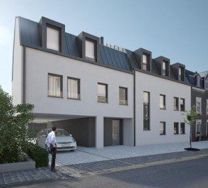 Bel appartement de 86,9m² situé au 1er étage d'une future résidence à 5 unités de haut standing sise à Nospelt, commune de Kehlen.   L'appartement dispose de:  Hall d'entrée, living/salle à manger , cuisine séparée avec accès au balcon, 2 chambre à coucher,  1 salle de douche, 1 WC séparé, terrasse, jardin privatif, garage fermé et 1 emplacement extérieur.  Le prix affiché est avec 3% de TVA.