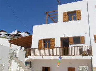 Location: CRETE/Almerida Price: € 199.500 Land Size: 450 m² Building Size: 100 m² Bedrooms: 3 Bathrooms: 3  3 bed house with terraces and garden and lovely views to the sea.  Within walking distance to ever popular Almyrida with its many tavernas, cafes and 'blue flag' beach.  This property is ideal as either a permanent residence or holiday home.  Flexible accommodation with everything on your doorstep.  This spacious semi-detached maisonette enjoys an elevated position overlooking Almyrida and with views to the wonderful White Mountains.  The property is on 3 levels and is walled and gated with plenty of outside space, low maintenance garden area and parking. All doors, windows and shutters are wood and the house sparkling white. The front door leads from a large terrace, covered in part by a closed pergola, into the spacious open plan lounge/kitchen/dining area decorated in cool white with warm terracotta floor tiling, log burner and wooden french doors, windows and kitchen units. There is a shower/ toilet under the stairs on this floor. The tiled staircase leads up to the master double bedroom with en suite shower room. From here, french doors lead out to a large roof terrace fully tiled and with views over looking the village of Almyrida to the sea and the magnificent mountains.  The lower level is entered from the living room by a white metal spiral staircase with wooden steps leading down to two bedrooms and a full bathroom. This level has its own outside access which opens on to a patio, garden and parking area.  The property comes complete with air-conditioning in the upper level, solar panel and white goods. It is also piped for central heating. There is also an agricultural water supply to the property which is of great benefit during the summer months. There is also a telephone line connected. This property would lend itself equally to either a holiday home or permanent residence in a quiet area with superb views. An ideal home for permanent or holiday l