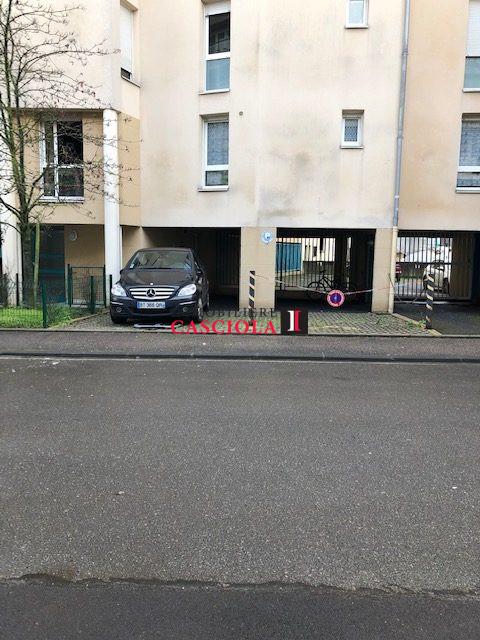 louer garage-parking 0 pièce 12 m² metz photo 2