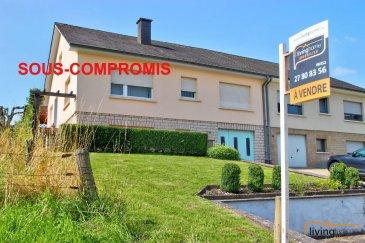 ***SOUS COMPROMIS***Belle maison jumelée avec grand terrain située à Boevange-sur-Attert à proximité de Mersch et Rédange-sur-Attert, construite en 1971 sur un terrain d\'une contenance de 15,86m2 avec un joli jardin aménagé dispose d\'une surface habitable de 132,65 m2 et d\'une surface diverse (sous-sol et grenier) de 143,35 m2.<br><br>DESCRIPTION:<br>Rez-de-chaussée: 106,35 m2<br>- hall d\'entrée et cage d\'escalier (24,15m2) <br>- chambre à coucher (22,10m2)<br>- buanderie (21,20m2)<br>- chaufferie (9,30m2)<br>- garage pour 1 voiture avec débarras (29,60m2)<br><br>Rez-de-jardin: 99,85 m2<br>- hall d\'entrée (14,70m2) et cage d\'escaliers (4,20m2) vers grenier<br>- cuisine équipée (15,20m2) avec accès direct vers terrasse (20m2) et jardin <br>- salle à manger et salon (21,80m2)<br>- chambre parentale (15,80m2)<br>- chambre 2 (11,35m2)<br>- chambre 3 (10,90m2)<br>- salle de bain (5,90m2)<br><br>Etage 1: <br>- salon <br>- chambre à coucher <br>- grenier aménagé (32,80m2) et non aménagé (37,00m2)<br><br>EXTERIEURS:<br>- 2-3 emplacements parking <br>- terrasse couverte 20m2<br>- grand jardin clôturé avec abris de jardin et potager<br><br>ASPECTS TECHNIQUES:<br>- construction en blocs béton et briques<br>- toiture recouverte d\'ardoises naturelles<br>- façade en crépi, non-isolée<br>- sols recouverts de carrelages et lino<br>- escaliers en construction métallique recouverts de marches en bois <br>- chauffage à mazout, citerne à mazout 4000 litres<br>- radiateurs<br>- châssis simple vitrage<br>- volets roulants manuels<br><br>SITUATION ET DISTANCES:<br>- Axe routier CR22, A7<br>- Mersch 9km<br>- Redange-sur-Attert 11km<br>- Ettelbruck 19km<br>- Luxembourg-Kirchberg 26km<br>- Arlon (B) 21km<br><br>SITUATION:<br>BOEVANGE-SUR-ATTERT fusionné avec la Commune de Helperknapp est située à 9 km de Mersch et à 11km de Rédange-sur-Attert.<br>Toutes les facilités qu\'offre la région de Boevange-sur-Attert, la Ville de Mersch et Rédange-sur-Attert comme p.ex.écoles fondamentales, 