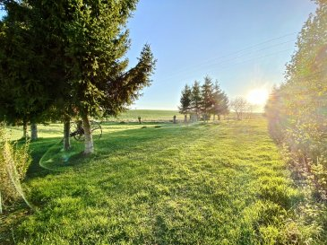 Terrain 14213 m2. Dans charmant petit village, terrain en partie constructible de 1 hectare 421 avec petit étang.