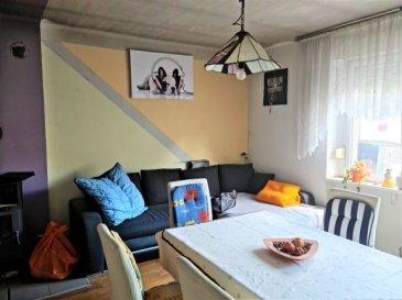 Maison mitoyenne un côté de 88.25 m2 comprenant une cuisine, un salon, une salle de bains, 3 chambres, un bureau, un sol-sol, double vitrage PVC, poêle à bois, terrain de 10.20 ares