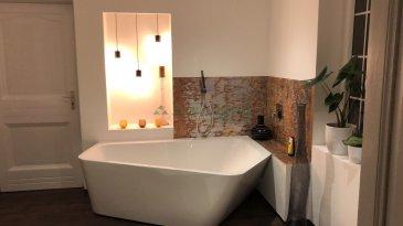Maison de village sur 12.14ares.  Maison de village de 146m2 entièrement rénovée sur 12.14ares. Vous trouverez au RDC : une entrée, cuisine équipée avec coin repas, salle d'eau avec WC, chambre. Au 1er étage, 2 chambres, salle de bain avec douche et baignoire donnant sur une terrasse couverte. 2ème étage : un séjour de 41m2 habitables (50m2 au sol) avec poêle nordique. Au sous-sol : cave, chaufferie-buanderie. Garage extérieur avec local de rangement. Magnifique jardin, arboré et clôturé, avec coin terrasse, biotop. Maison 'Coup de coeur' dans un état impécable, sans travaux à prévoir.