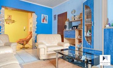 Situé à Tétange, cet appartement se trouve au premier étage d'une résidence de onze unités construite en 1920. Il offre une surface habitable ±68 m² et se compose comme suit:  Un hall d'entrée de ± 7 m² distribue les accès aux différentes pièces à savoir: Un séjour de ± 18 m², une cuisine de ± 15 m², une salle de bain de ± 5 m² avec WC et baignoire équipée de parois de douche, et enfin deux chambres de respectivement ± 14 m² et ± 9 m².  Au sous-sol, une cave de ± 4 m² fait partie également des lots vendus. Les locaux communs comprennent une buanderie de ± 22 m², un local étendoir pour sécher le linge de ± 12 m² et un local poubelles de ± 7 m².  Un garage privatif de ± 40 m² pouvant accueillir 3 voitures complète l'offre.  Informations complémentaires :  - L'appartement est en bon état.  - Fenêtre PVC double vitrage  - Sol en carrelage.  - Charges de 150 € par mois  Agent responsable : Gaëtan Lupinacci Email : gaetan@vanmaurits.lu GSM : (+352) 671.157.120