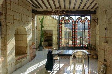 A dix minutes de Saumur, proche Montsoreau, cette jolie maison tuffeau vous séduira par son charme et son originalité&period;<br />Elle offre en rez de chaussée une grande entrée, une cuisine aménagée et équipée, un cellier, un agréable salon sur tomettes avec cheminée, une grande salle à manger avec coin bar en partie troglodyte, avec une superbe verrière ouvrant sur le jardin, une chambre &lpar;avec point d\'eau&rpar; et des wc<br />Au premier étage : 2 chambres &plus; une chambrette, un espace bureau, une salle d\'eau, une salle de bains et des wc<br />Grenier, caves, jardin, grande dépendance avec atelier, puits&period;