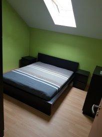 APPARTEMENT de +/- 40 m2, avec entrée individuelle, avec Cuisine équipée + Living, Salle de Douche, 1 chambre à coucher, Rangement, 1 Parking extérieur.