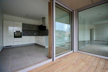 RE/MAX Partners Plus, spécialiste de l'immobilier à Mondorf-Les-Bains, vous propose en location  dans une résidence neuve, ce très joli appartement lumineux d'une chambre. Il dispose d'une superficie habitable d'environ 70m². De très beaux volumes s'offrent à vous, et il se compose comme suit :  - D'un vaste hall d'entrée avec placards intégrés, - D'une cuisine équipée fonctionnelle ouverte (full électroménager), - D'un spacieux living lumineux d'environ 30m² donnant accès sur la terrasse de 6m² environ, - D'une grande chambre à coucher de 16m², avec salle de douche à l'italienne et WC privatif, - D'un WC séparé avec point d'eau, - D'un local technique (débarras), - D'une cave privative, - D'un parking intérieur privatif avec porte automatique télécommandée, - Une buanderie commune, un local à vélo et un local poubelle complètent cet appartement.  La construction de cet appartement est d'une qualité et d'une prestation de grand standing grâce à une sélection rigoureuse des matériaux utilisés :  -  Ventilation mécanique à double flux individuelle. -  Volets roulants électriques, -  Fenêtres triple vitrage Schüco, -  Bâtiment à basse consommation, -  Porte palière de type blindée,  -  Vidéophonie  Proche de toutes commodités : parking au pied de l'immeuble, bus, station essence, crèche à 2 min à pieds, écoles, centre-ville, surface commerciale Match à 2 min à pieds, banques,, etc....  A visiter....  Disponibilité immédiate.  CONTACT : MICHAEL CHARLON au 621 612 887 ou par Mail : michael.charlon@remax.lu Ref agence :5095770