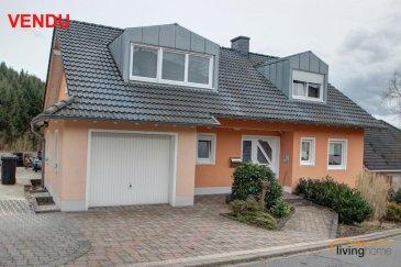 -- FR --  ***VENDU***Belle maison contemporaine, libre de 4 cotés, située au calme avec une vue dégagée sur la vallée de l\'Our. La maison d\'habitation peu servir comme maison unifamiliale ou maison bi-familiale, grâce à une entrée séparée à l\'arrière du bâtiment. Le bien dispose une grande et spacieuse terrasse, partiellement couverte. La maison dispose d\'une surface totale de 257,28 m2 dont +/- 200 m2 habitable. Connexion ligne autobus vers Ettelbrück/Luxembourg à proximité, Hosingen/N7 à 5 min.  DESCRIPTION: * Rez-de-chaussée: Hall d\'entrée(8,89m2), Cuisine équipée ouverte(12,21m2), espace repas donnant sur salon(30,36m2) (accès vers balcon panoramique), chambre à coucher(16,38m2), salle de douches(5,13m2), garage(17,42m2) pour 1 voiture. * Étage: Hall de nuit(10m2), salle de douches(17,15m2) (douche italienne), 2 chambres à coucher(20+30m2), terrasse de toit * Sous-sol: Hall avec sortie vers terrasse(14,32m2), salle de bains(6,03m2), 2 chambres à coucher(13,64 + 13,80m2), grande pièce aménageable en salon/bureau/hobby(25,72m2), chaufferie Terrasse partiellement couverte avec accès vers jardin et espaces verts aménagés + aire de jeux  Compléments de photos disponibles sur demande.  Votre contact LIVINGHOME immobilier: - Pascal POOS             +352 621 36 20 26 - Bureau                        +352 27 80 83 56  -- EN --  Nice exposed 1-2 family house, in a quiet location with a view of the Ourtal. Bus line to Ettelbrück / Luxembourg nearby, Hosingen / N7 within 5 minutes by car.  DESCRIPTION * Ground floor: entrance area, fitted kitchen with open dining and living area (access to balcony with panoramic view), bedroom, bathroom with shower, garage for one car. * First floor: hall, shower room, 2 bedrooms, roof terrace * Cellar floor: hall with exit to the terrace (partly covered), bathroom with tub, 2 bedrooms, large room as living room / office / hobby usable, boiler room  Terrace with access to green areas + playground  Additional photos available upon reques