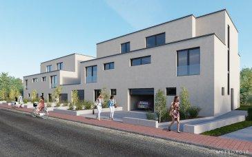 Construction d'une maison jumelées Lot 2 sur un terrain de 4,14 ares d'une surface de 187,24m2 habitable, qui se compose comme suit :  au rez-de-chaussée  - garage pour 1 voiture - chaufferie  - 1 emplacement extérieur - hall d'entée - wc séparé - buanderie - cuisine ouverte - salon / salle à manger de 30,46m2 - terrasse de 14,90m2  1er étage  - 1 chambre à coucher principale avec dressing et salle de bains intégrée - 2 chambres à coucher - salle de bains / douche / WC  2ième étage  - hall - 2 chambres à coucher dont une avec dressing - salle de douche / WC - terrasse 13,81m2  Les prix de vente sont publiés à 3% TVA.