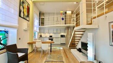 Loft à louer  Situé rue Jean l'Aveugle à 2 pas du Glacis, FINE Properties vous propose en location cet appartement meublé du style Loft d'une surface habitable de 84 m² répartie sur 2 niveaux.  Entièrement aménagé avec du mobilier contemporain et des finitions de haut standing, l'appartement se compose comme suit:  Hall d'entrée, cuisine ouverte, grand séjour, salle de bains et WC séparé.  A l'étage se trouve une chambre en mezzanine avec bureau et de nombreux dressings.  L'équipement de ce loft comprend, entre autres, une machine à laver, un sèche-linge, télévisions, système HIFI, aspirateur central, volets électriques, chauffage au sol, poêle scandinave et parquet massif.   Dans les charges de 250 EUR sont compris : eau, électricité, chauffage, télévision et internet.   Disponible de suite.  Pour toute information complémentaire, veuillez contacter notre bureau. Ref agence :62