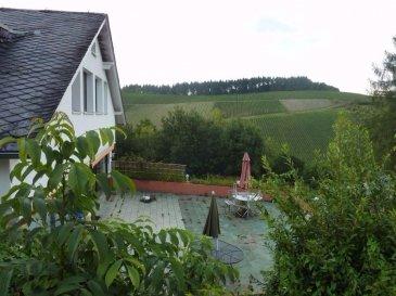 """""""Ein außergewöhnlicher Besitz am Trier Stadtrand""""  Dieser außergewöhnliche Besitz besticht durch seine einzigartige Lage in Trier - Kürenz am Rand des Höhenstadtteils Petrisberg. Es bietet einen Panoramablick auf die Weinberge des Avelertals und hat eine Gesamtwohnfläche von ca. 400 qm, und verfügt daneben über eine weitere Nutzfläche.  Das sehr große Grundstück, das sich bis ins untere Avelertal erstreckt, umfasst 1.000 qm  Bauland, 11.000 qm Garten (Rasen, Wald, Terrassen), eine Garage, 2 Parkplätze und 4 verschiedene Gebäude.  Hauptgebäude (3 Etagen von jeweils ca. 130 qm): Das Hauptgebäude wurde 1965 zuerst als Bungalow gebaut. Auf diesen Bungalow wurde 1989 vom heutigen Besitzer eine zusätzliche Etage mit Dach gebaut.  •Im EG dieser Immobilie befinden sich ein Eingangsbereich mit Gäste WC, ein Kaminzimmer, ein separater Elternbereich mit einem Schlafzimmer, einem Duschbad und einem Ankleidezimmer. Links vom Eingangsbereich befinden sich Küche, Esszimmer und Wohnzimmer. Die 3 Räume bieten einen schönen unverbaubaren, nicht einsehbaren Blick auf das Avelertal und die Weinberge. Das Wohnzimmer (ebenfalls mit Kamin) öffnet sich zu einer ca. 75qm großen SO orientierten Terrasse (mit Markise) und zum Garten.   •Im DG befinden sich zurzeit 4 Wohneinheiten (1 Zimmer, Kochnische, DU/WC, PVC Boden) à ca. 30qm, mit einem separaten Eingang. Diese Etage könnte ohne Probleme mit dem Erdgeschoss verbunden werden. •Im UG befinden sich 2 weitere Zimmer (mit Fenster), ein Badezimmer, ein Waschraum, ein Technikraum, ein Lagerraum und ein Zugang zum Garten.  Nebengebäude Nr. 1: •Es handelt sich um ein ehemaliges Schwimmbad, das aus Kostengründen in 2 separate Wohneinheiten (1 Zimmer mit Laminat Boden, Kochnische, DU/WC) umgewandelt wurde à 30qm. •Baujahr 1965.  Nebengebäude Nr. 2: •Es handelt sich um ein Holzgebäude, das zurzeit als Lager benutzt wird, es könnte aber auch als Wohnbereich genutzt werden. •Baujahr 2014  Nebengebäude Nr. 3: •Es handelt sich um ein Gebäude, das als Ga"""
