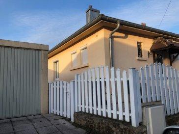 Maison de plein pied de type F3 avec garage et jardin. Maison de plein pied de type F3 avec garage et jardin