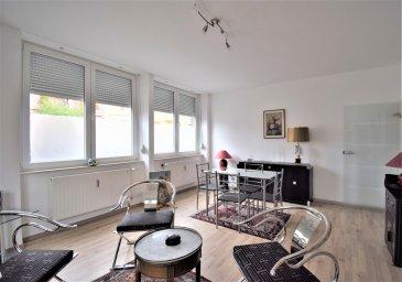 Situé rue de l'Usine, à deux pas du centre-ville d'Esch-sur-Alzette et du Parc Laval, cet appartement entièrement meublé et récemment rénové occupe le rez-de-chaussée d'une petite copropriété de 3 unités. D'une surface habitable nette de ± 59 m² pour une surface totale de ± 89 m², il se compose comme suit :   La porte d'entrée s'ouvre sur un hall ± 3 m² desservant un lumineux séjour ± 23 m², une cuisine aménagée et équipée ± 12 m² munie d'une grande table et une chambre ± 10 m². À droite de la cuisine, un couloir ± 3 m² avec rangements encastrés dessert un WC séparé ± 1 m² et une salle de douche ± 5 m² avec lavabo, sèche-serviettes et raccordement pour une machine à laver. Toujours au rez-de-chaussée se situe un garage de ± 15 m² avec entrée directe dans l'immeuble. Au sous-sol, une cave ± 15 m² complète cette offre.   Généralités : •Appartement en bon état général, rénové en 2019. •Double vitrage. •Garage inclus. •Situation calme. •Proximité commerces, écoles, restaurants, … •Garantie bancaire de 2 mois : 2300,00 €. •Frais d'agence : 1 mois de loyer + TVA 17 %. •Loyer mensuel : 1150,00 €. •Charges mensuelles : 150,00 €.    Agent responsable : Gaëtan LUPINACCI Mobile : +352 671 157 120 Email : gaetan@vanmaurits.lu