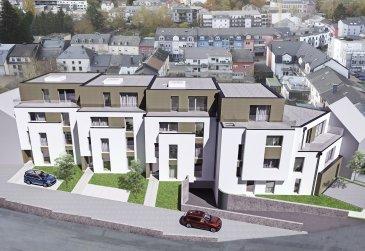 Fis Immobilière vous présente 4 nouvelles résidences à toitures plates de style contemporain dans une rue calme et sans issue dans la ville de Tétange. Les 4 résidences regroupent 12 logements en tout. 4 Résidences ont chacune 2 appartements et 1 Penthouse sur deux niveaux par bâtiment, le sous-sol est commun aux 4 bâtiments. Les 4 résidences comprennent 24 emplacements intérieurs et 2 emplacements extérieurs. Les 2 autres bâtiments ont 2 duplex chacun avec un sous-sol séparé pour les deux bâtiments qui disposent de 4 caves et de 4 emplacements intérieurs doubles. Les 4 Penthouse sur deux niveaux auront des entrées complètement séparés comme dans une maison.  Chaque appartement dispose d'une cave privé.  Les appartements sont spacieux et lumineux disposant de 2 à 4 chambres à coucher avec une voir 2 terrasses par appartements.  Les appartements situés au rez - de - chaussée dispose d'un jardin privé.  Chaque détail a été ici pensé afin de proposer aux futurs occupants un confort de vie optimal.  Des équipements et matériaux haut de gamme sélectionnés avec le plus grand soin, des espaces extérieurs comme des terrasses et jardins privés pour les appartements au rez-de-chaussée et des terrasses avec une vue dégagée pour les biens aux étages supérieurs .