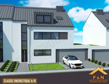 *** NOUVEAU PRIX *** NEUER PREIS *** NEW PRICE ***  F&N Promotion vous propose une nouvelle maison, situé à Reuland, construite dans un style moderne, avec une surface habitable de +-290m2 - 5 min du Junglinster, 15 min du Kirchberg – Luxembourg. (Classe énergétique A/B)  Reuland (commune Heffingen) dispose de toutes les infrastructures nécessaires (crèche, école, foyer de jour, etc.), à proximité de la ville Junglinster, ou vous trouverez toutes commodités nécessaires.  La maison se compose comme suite:  Rez-de-chaussée: -hall d'entrée avec vestiaire (17.34 m2),  -un spacieux living (54.53 m2) trés lumineux avec une vue et accès vers la terrasse (31.63 m2) et le jardin (cuisine ouverte) -       chambre à coucher (18.70 m2) avec salle de bain (4.55 m2),  -WC séparée (2.31 m2),  -buanderie / cellier (15.16 m2) -un garage pour 2 voitures, et emplacement devant la garage (32m2)  1ér étage: -spacieux coulouir de 16.65 m2 -chambre à coucher de 22.00 m2, avec salle de bain (6,08 m2) et dressing (6.77 m2) -chambre à coucher de 15.71 m2 -chambre à coucher de 18.10 m2 -chambre à coucher de 16.44 m2 -salle de douche de 7.16 m2  Combles:  aménageable:  -79.52 m2 avec 2m+ hauteur  -local technique (6.17 m2)  Le prix est indiqué avec 3% TVA incluse.  N'hésitez pas, prenez contact avec nous et laissez vous guider pour votre futur projet.  Tél.: +352 621 13 99 88 E-Mail: info@fn-promotion.lu Ref agence: RL-MA02  -------------  F&N Promotion präsentiert Ihnen ein modernes Haus (Neubau), mit einer Wohnfläche von ca. 250 m2, 5 Minunten von Junglinster, und ca. 15 Minuten von Kirchberg-Luxemburg entfernt. (Energieeffizienz- und Wärmeschutzklasse A/B)  Reuland (Gemeinde Heffingen) bietet Ihnen jede nötige Annehmlichkeit (Krippe, Schule, Kindertagesstätte, etc.) in Reuland selbst, sowie auch im naheliegenden Junglinster.   Das Haus beinhaltet:  Im Erdgeschoss: -Eingangshalle von 17.34m2 -ein geräumiges, gut belichtetes Wohnzimmer (54.53m2) mit Blick und Zugang zur Terrasse (31.63m2)) un