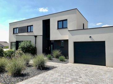 A 5 minutes de la frontière luxembourgeoise  HUSSIGNY-GODBRANGE, 535.000 Euros  Super Maison Basse Energie 4 côtés libres (+-159m2) sur un Terrain (+-7.02 ares) clôturé avec Piscine (6.15 X 4.15m). Construction 2013.  Situation très calme et verdoyante. Objet moderne très bien entretenu.  Garage (+-27.15m2, 2 emplacements extérieurs)  RDCH: Hall d'entrée, Living (+-60m2) donnant sur cuisine équipée ouverte haute gamme avec accès Terrasse (+-35m2 / Exposition Sud-Ouest) avec Piscine couverte (4.15m X 6.15m) au Chlor) . Buanderie (+-6.88m2), Vestiaire (+-3.91m2), WC séparé.  1ier étage: 4 chambres (+-11.56m2 / 11.56m2 / 12m2 / 11.56m2) dont une avec son Dressing et sa salle de douche italienne, salle de bains (+-5.88m2)  Equipements: Dalles en Béton, Triple vitrage PVC avec volets électriques (2013), Chauffage gaz aux sols (2013),  Toit (plat / isolé / 2013), Electricité (2013),  Façade (Agglo 30cm / isolé /  2013), Sanitaire (2013), Alarme, Adoucisseur d'eau.  Super Affaire à saisir....   ***HERBY IMMO = MEILLEURS PRIX DU MARCHE***   (Herby Immo vous garantit le prix d`achat le moins cher du marché)