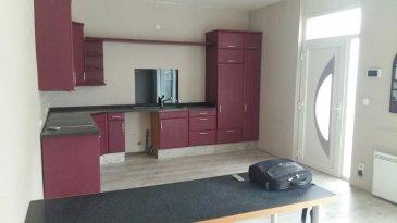 Appartement en rdc avec jardin, comprenant cuisine ouverte sur séjour, 1 chambre, bureau avec mezzanine, salle de bains et WC.