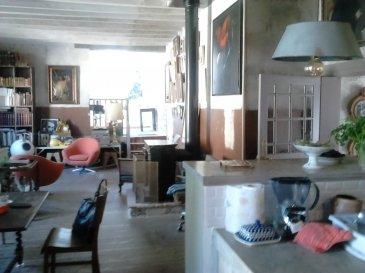 MAISON CENTRE VILLE DE LA CHARTRE SUR LE LOIR.  MAISON renovée, pleine de caractère et atypique, située au centre ville de LA CHARTRE SUR LE LOIR comprenant :<br> Au RDC : une belle entrée, une très grande pièce aménagée actuellement à usage d\'atelier, une chambre avec slle d\'eau, un grand séjour double avec une pièce attenante et une cuiisine ouverte;<br> A l\'étage : trois grandes chambres sous combles, un dégagement et un salle d\'aeu buanderie.<br> Au sous-sol : deux pièces de rangements et des remises;<br> En plus, un commerce d\'une surface d\'environ 30 m2<br> Double vitrage sur toutes les ouvertures avec verre anti-infraction sur le devant<br> Une cave<br> Une autre cave dans le roc<br> Une cour et un jardin avec un bord de loir<br> CONTACTEZ Laurence DEVILLERS Tél : 06 29 71 10 77