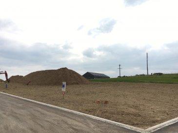 Joli terrain à bâtir (Lot 14) de +/- 7,40 ares dans un nouveau lotissement pour construction d'une maison 4 façades situé