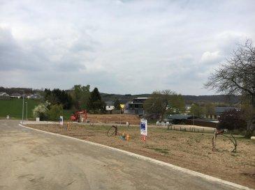 Joli terrain à bâtir (Lot 8) de +/- 7,17 ares dans un nouveau lotissement pour construction d'une maison jumelée par garage situé