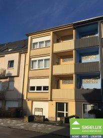 Luxembourg-Limpertsberg (rue Joseph Hansen)  A VENDRE:  Maison de rapport avec 2 appartements :  RDC : Garage (1 voiture)  2 caves individuelles  Buanderie commune Chauffage commun (Gaz – 2004)  Jardin (72,87 m2)  1ier étage : Appartement de 64,27 m2 + 2 Balcon 1 chambre à coucher (Parquet) 1 Living avec balcon 1 cuisine équipée avec balcon 1 Salle de douche  1 W.C. séparé  2 et 3 étage : Appartement-Duplex  Living-Salle à manger avec feu ouvert et balcon Cuisine équipée avec balcon W.C. séparé ------- 3 chambres à coucher dont 2 avec balcon 1 bureau  1 salle de bains Accès grenier ------- Grenier privatif aménageable  Les + : Situation calme Propriétaire unique Bon état général d'entretien Grand Potentiel  Quartier résidentiel du Limpertsberg très recherché  Chauffage au Gaz : 2004 Nouvelles fenêtres : 2014 Cuisine et salle de bains récentes.   Pour plus de renseignement ou un rendez-vous pour visiter contactez : SIGELUX : 46 71 31 ou info@sigelux.lu