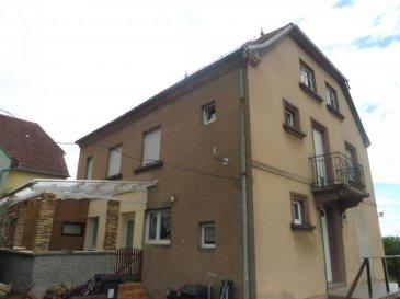 Immeuble 2 lots. Grande maison d\'environ 160 m² composée de 2 appartements T3 avec chacun une cuisine équipée et une chaudière individuelle au gaz. L\'appartement du rez de chaussée dispose aussi d\'une terrasse et la maison offre un sous sol avec cave et garage. A l\'arrière se trouve également une dépendance d\'environ 70m², le tout sur un terrain de 980 m². Idéalement situé à MONTBRONN. Contact Nord Sud immobilier au 03 72 64 01 02