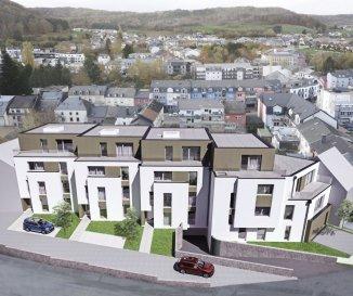 Appartement A2 Appartement d'une surface de +ou- 99m2 situé au premier étage avec une terrasse de +ou- 4.26m2. L'appartement dispose de deux chambres à coucher de 14.57m2 et 16.28m2, une salle de bains, un dressing, un Wc séparé et une cave privative.  Vous pourrez acquérir un emplacement intérieur au prix de 30.000,00€ ou un emplacement extérieur au prix de 15.000,00€.  Le projet comprend 6 nouvelles résidences à toitures plates de style contemporain dans une rue calme et sans issue dans la ville de Tétange.  Les 6 résidences regroupent 16 logements en tout.  4 Résidences ont chacune 2 appartements et 1 penthouse sur deux niveaux par bâtiment, le sous-sol est commun aux 4 bâtiments. Les 4 résidences comprennent 24 emplacements intérieurs et 2 emplacements extérieurs.  Les 2 autres bâtiments ont 2 duplex chacun avec un sous-sol séparé pour les deux bâtiments qui disposent de 4 caves et de 4 emplacements intérieurs doubles. Les 4 duplex auront des entrées complètement séparés comme dans une maison.  Chaque appartement dispose d'une cave privé. Les appartements sont spacieux et lumineux disposant de 2 à 4 chambres à coucher avec une voir 2 terrasses par appartements.  Les appartements situés au rez - de - chaussée dispose d'un jardin privé.  Chaque détail a été ici pensé afin de proposer aux futurs occupants un confort de vie optimal. Des équipements et matériaux haut de gamme sélectionnés avec le plus grand soin, des espaces extérieurs comme des terrasses et jardins privés pour les appartements au rez-de-chaussée et des terrasses avec une vue dégagée pour les biens aux étages supérieurs .