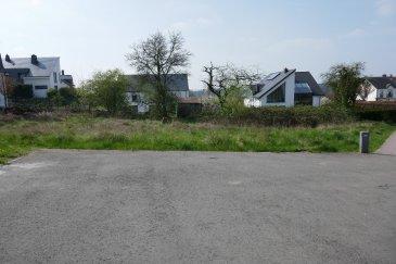 Beau terrain à bâtir de 9a76ca pour la construction d'une grande maison unifamiliale libre de 4 côtés dans un  beau lotissement  nommé « Vir Herel» sis à Sandweiler.   Le terrain est libre de contrat de construction!!
