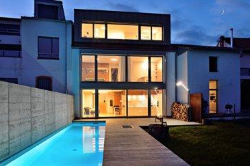 Thionville Guentrange village :  magnifique maison  d\'architecte. Dans le vieux Guentrange, magnifique \'maison passive\' d\'architecte, construction ossature bois sur dalle béton .<br>Rez-de-chaussée  composé d\'une cuisine ouverte sur pièce séjour de 35 m2  avec cheminée donnant accès au jardin, piscine et sauna + une lingerie.<br>A l\'étage : une mezzanine, deux chambres, une salle de bains et un wc séparé<br>Combles aménagés : deux chambres dont une suite parentale avec salle d\'eau.<br>Rangements intégrés dans toute la maison<br>Chauffage  par le sol <br>Isolation intérieure et extérieure des murs Triple vitrage-Menuiseries extérieures bois et ALU<br> prestations de grande qualité.<br><br>Contacts : E. Worms : 06.07.54.22.65<br>                   K. Karas : 06.08.31.19.87 dont 2.06 % honoraires TTC à la charge de l\'acquéreur.<br>