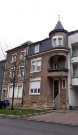 IMMO-SUD vous propose cette charmante maison située à Differdange, sur un terrain de 2a90ca, avec une surface habitable de +/-180m2.  La maison est composée de deux appartements et un duplex.  -Appartement au ( rez-de-chaussée ) Comprenant : hall d'entrée, salon, cuisine équipée, salle de douche, 1 chambre à coucher accès sur terrasse et jardin.  - Appartement (1er étage)  Comprenant : hall d'entrée, salon, cuisine équipée, salle de douche, 1 chambre à coucher, balcon.  -Duplex (2éme étage)  Comprenant: hall d'entrée, cuisine équipée,salon, 3 chambres à coucher, salle de douche, (en cours de rénovations)  - Sous-sol: Buanderie, 3 caves avec accès sur une grande terrasse et jardin   La maison est en rénovation, compteurs séparés, double vitrage, toiture en bon état,chauffage au gaz       Ref agence :5367665
