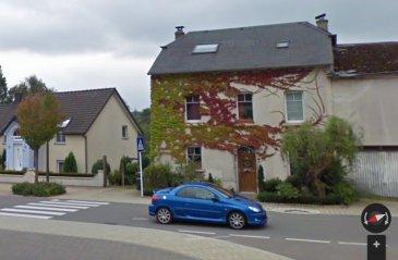 Grande maison rénovée à vendre à Bous.