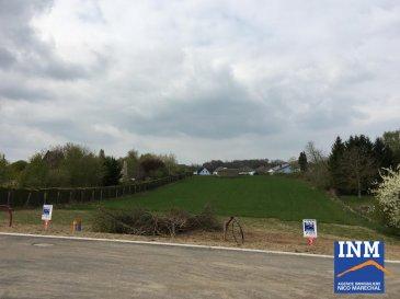 Joli terrain à bâtir (Lot 4) de +/- 7,52 ares dans un nouveau lotissement pour construction d'une maison jumelée par garage, situé