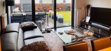 En exclusivité chez Active Invest :  Un appartement très lumineux avec grande terrasse de 12.65m2 et jardin privatif de 93.25 m2 sis   Au RDJ d`une résidence quasi neuve de 2017, dans la cité