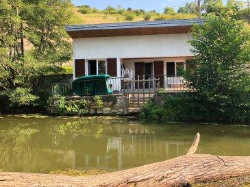 Maison individuelle comprenant entrée sur pièce de vie avec cuisine ouverte, une chambre, salle d'eau avec wc, terrasse à la vue tournée vers la Nature.