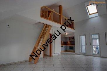 Bel et spacieux appartement avec mezzanine ( surface totale: 132.95 m2) dans une résidence contemporaine de 3 logements, situé au centre de la ville de Diekirch. Le bien immobilier est réparti sur 2 étages à savoir: appartement 3e étage (+/- 97,95 m2) et mezzanine (+/- 35,23 m2). L\'accès vers l\'appartement est garanti par un ascenseur.<br><br>DESCRIPTION:<br>Etage 3: Hall d\'entrée (4,15m2), Salle de bains (10,78m2), WC séparé (1,42m2), Chambre à coucher 1 (10,20m2), Chambre à coucher 2 (9,25m2), Cuisine ouverte équipée (14,75m2), Living/salon spacieux (47,75m2) donnant accès sur balcon (2,15m2)<br><br>Etage 3+: Grande mezzanine (24,75m2), WC/Lavabo (10,25 m2)<br><br>Rez-de-chaussé: Garage pour 2 voitures (23,47m2)<br><br>Pour de plus amples renseignements contactez-nous:<br>- Carine DEI CAMILLO      621 45 32 08<br>- Pascal POOS                  621 36 20 26<br>- Bureau                              27 80 83 56<br />Ref agence :3497354