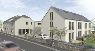 Dans un quartier résidentiel, entouré de verdure, cet appartement duplex est localisé dans le complexe