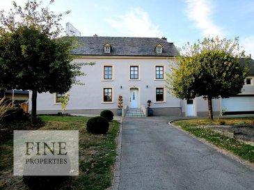 *** A Vendre ***  16, route de Luxembourg - L-6910 ROODT/SYRE  Cette ancienne demeure de 1824 fut entièrement rénovée et transformée au cours des décennies passées, une dernière rénovation partielle a été réalisée en 2004 (éléctricité, sanitaire, chauffage), nouvelle façade en 2014.  Construite sur un terrain de 6,54 ares, la bâtisse (la maison principale et le garage furent transformées en un ensemble) offre une surface totale de ±390 m², dont ±240 m² habitables qui se repartit sur 3 étages.   La partie maison se compose comme suit :  Rez-de-chaussée Hall d'entrée, double séjour de 38 m², cuisine équipée, WC séparé, salle de douche/buanderie  1er étage 4 chambres à coucher, bureau et une salle de bains (baignoire,douche, WC)  Grenier aménageable de 84 m²  La partie garage comprend :  Rez-de-chaussée Garage pour 2 voitures 50 m²  1er étage Salle de loisirs 54 m² et chaufferie (mazout)  Pour tout complément d'informations veuillez contacter notre bureau au +352 20 60 15 Ref agence :88