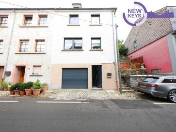 -- FR --  New Keys vous propose en exclusivité cette belle maison à Ettelbruck libre de trois côtés d'une surface totale de 152,4 m². La maison complètement rénovée et disposant d'un vaste terrain de 14 ares (non constructible) se présente de manière suivante:  Au RDC: - Hall d'entrée - living lumineux (22,55 m²) - cuisine équipée (16,3 m²) - WC séparé - petite terrasse à l'entrée  Premier étage: - 3 chambres (11,09 m², 10,71 m², 17,9 m²) - salle de bain avec douche  Grenier: - chambre à loisirs (18 m²) - garde-robe intégrée (7,5 m²) - chambre avec baignoire ouverte et télévision intégrée au plafond - terrasse (17,22 m²) Cave avec garage  La maison est idéalement située et se trouve proche de toutes commodités ! (bus, train, autoroutes) À visiter absolument!  N'hésitez pas à nous contacter au 661 333 492 ou par mail mserrecchia@newkeys.lu pour plus d'informations ou une éventuelle visite.  COVID: Pour votre sécurité, nos visites sont effectuées avec des masques.       -- EN --  New Keys is offering exclusively this lovely house in Ettelbruck with a total surface area of 152,4 m². The house situated on a property of 14 are has been completely renovated and is composed as follows:  Ground floor: - entrance area - big and bright living room (22,55 m²) - fully equipped kitchen (16,3 m²) - separate toilet - little terrace at the entrance First floor: - 3 bedrooms (11,09 m², 10,71 m², 17,9 m²) - bathroom with shower  Attic: - leisure room (18 m²) - walk-in wardrobe (7,5 m²) - bedroom with open bathtub and extendable television from the ceiling  - terrace (17,22 m²) Cellar with garage  The house is ideally situated near all amenities (train, bus, highway).  Please do not hesitate to contact us for further information or if you would like to make a visit! 661 333 492 or mserrecchia@newkeys.lu  -- LU --  New Keys bitt Iech exklusiv dëst wonnerschéint Haus mat dräi fräien Säiten zu Ettelbréck mat enger Gesamtfläch vun 152,4 m². D'Haus, wat sech op engem 14 Ar groussen Grondst